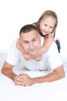Free Father And Little Daughter Lying On A Bed Royalty Free Stock Image - 20640806