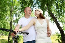 Young Couple On The Bikes In The Park Royalty Free Stock Photos