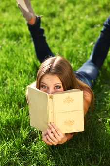 Woman In The Park With Book Stock Images