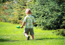 A Little Boy Walks In The Park Royalty Free Stock Image