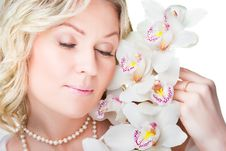 Blonde Woman With Orchid On Isolated White Stock Photo