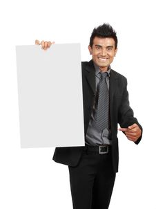 Businessman Holding A Blank Sign Royalty Free Stock Images