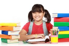 Free Image Of Schoolgirl Smiling With Many Books Royalty Free Stock Photo - 20646785