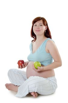 The Pregnant Woman With An Apple Stock Images