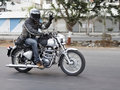 Free Motorbiker In Motion Doing Peace Sign Stock Images - 20651764