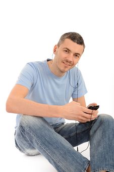 Free Casual Young Man With Cell Phone And Headphones Stock Photos - 20650403