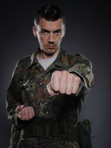Free Portrait Of Soldier In Camouflage Fighting Royalty Free Stock Photos - 20650488