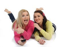 Free Two Pretty Woman Friends Watching Television Royalty Free Stock Photo - 20650535
