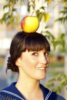 Free Girl With An Apple On The Head Stock Photography - 20651562
