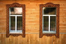 Free Two Windows With Wooden Platbands Stock Images - 20652614