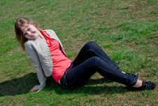 Free Girl Sitting On The Grass Royalty Free Stock Image - 20653636