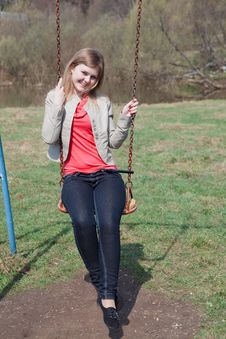 Free Young Girl In The Park Sitting On The Swing Royalty Free Stock Photos - 20653878