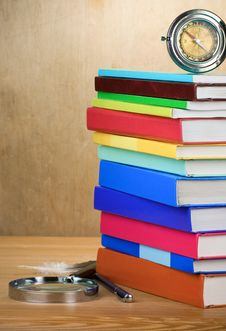 Pile Of Books, Magnifier And Compass Stock Photos