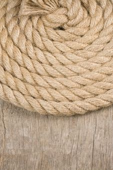 Free Ship Ropes And Knot On Wood Texture Royalty Free Stock Image - 20654826