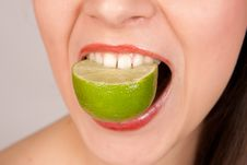 Free Girl Biting Lime Stock Photo - 20655070