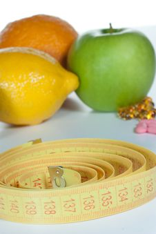 Tape Measure, Diet Pills And Fruits Royalty Free Stock Images