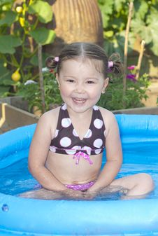 Happy Little Girl In A Swimming Pool Stock Image