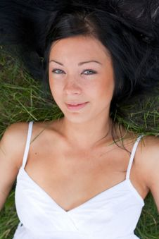 Free Portrait Of A Girl Lying On Grass Royalty Free Stock Images - 20656649