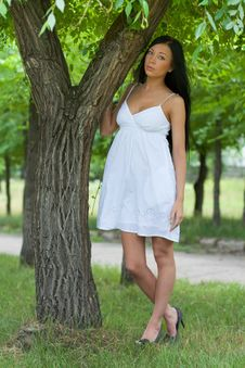 Free Girl Standing By A Tree Stock Image - 20656651