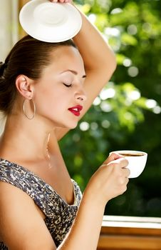 A Young Attractive Woman With A Cup Of Coffe Royalty Free Stock Image