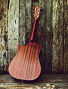 Free Back View Acoustic Guitar On Wood. Stock Images - 20661344