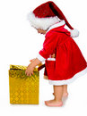 Free Little Girl In Santa Hat With Presents Royalty Free Stock Photos - 20662868