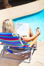 Free The Woman With Newspaper Near The Pool Royalty Free Stock Photos - 20664588