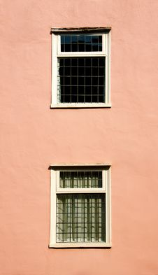 Windows On A Pink Wall Royalty Free Stock Photo