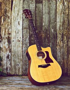 Free Acoustic Guitar On Wood. Stock Photography - 20661252