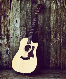 Free Acoustic Guitar On Wood. Stock Photography - 20661282