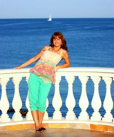 Woman On A Balcony By Sea (ocean) Stock Images