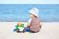 Free Playing On The Beach Royalty Free Stock Photography - 20667317