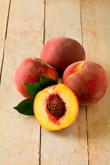 Free Peach On Wooden Table Royalty Free Stock Image - 20667396