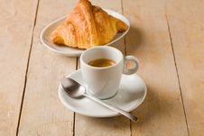 Coffee And Croissants On Wooden Table Stock Photography