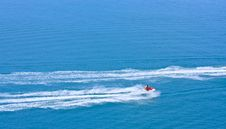 Free Jetski Racing On Blue Water Royalty Free Stock Image - 20671276
