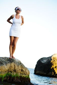 Woman Standing On A Stone In The Sea Royalty Free Stock Photos