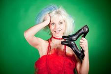 Free Blonde Crazy Girl Holding Shoes Royalty Free Stock Photography - 20673287