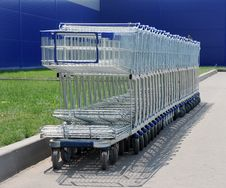 Row Of White Shopping Carts Stock Image
