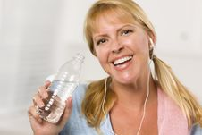 Free Pretty Blonde With Towel Drinking Water Bottle Stock Photo - 20676710