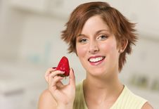 Free Pretty Red Haired Woman Holding Strawberry Stock Image - 20676741