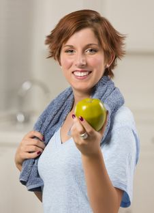 Pretty Woman With Towel Holding Green Apple Royalty Free Stock Photography