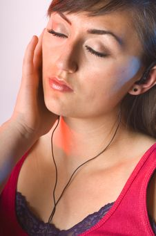 Teen Woman Listening To Music On White Stock Photography