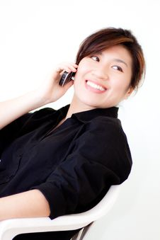 Asian Woman In Black Shirt With Telephone Royalty Free Stock Images