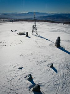 Tower On Snow Covered Mountain Stock Image