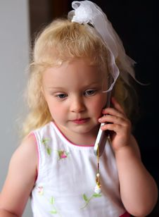 Free Little Caucasian Girl Listening To Mobile Phone Stock Photo - 20685760