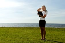 Free Girl With A Folder On The Background Of The Sea Royalty Free Stock Photo - 20690925