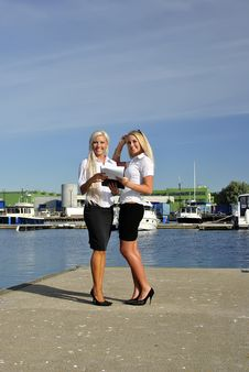 Free Two Girls With The Documents Standing On The Pier Royalty Free Stock Images - 20691019