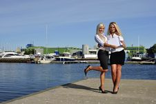 Two Girls With The Documents Standing On The Pier Stock Photos
