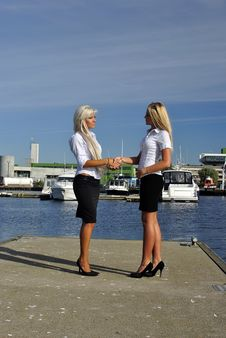 Free Two Girls Blonde Stand On The Pier And Greet Stock Photo - 20691140