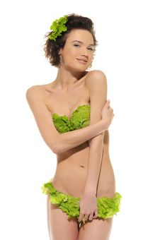 Sexy Woman With Cabbage And Green Lettuce Stock Images